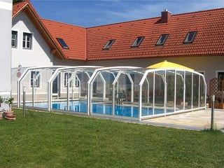 Look inside swimming pool enclosure OCEANIC throught clear polycarbonate panels