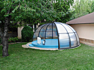 Pool enclosure ORIENT protects pool from debris and insects