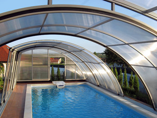Popular wood-like finish used on pool enclosure RAVENA