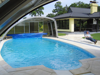 Pool enclosure RAVENA with dark polycarbonate filling for privacy