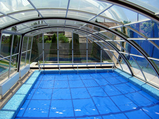 Inground pool enclosure RAVENA - detail look from inside of the enclosure