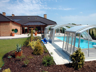 Retractable pool enclosure RAVENA uses an interesting shape