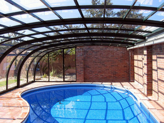 Lean-to patio and pool enclosure STYLE protects your pool and keeps it cleaner