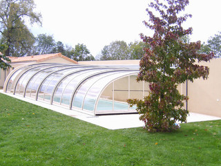 Pool enclosure STYLE over pool near by house also creates an enclosed patio space