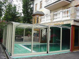Fully closed pool enclosure VISION attached to house