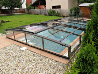 Retractable pool enclosure VIVA is fully closed or opened easily