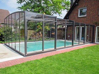 Retractable swimming pool enclosure Vision attached to the house