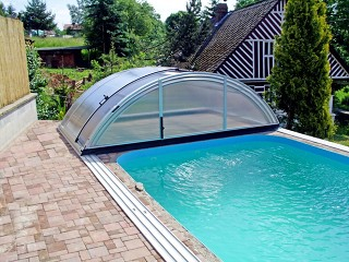 Retracted swimming pool enclosure Universe NEO