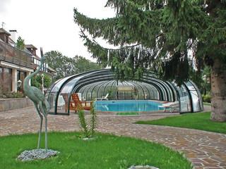 Zasuwane zadaszenie basenowe OLYMPIC pozwala Ci na korzystanie z basenu przez cały rok