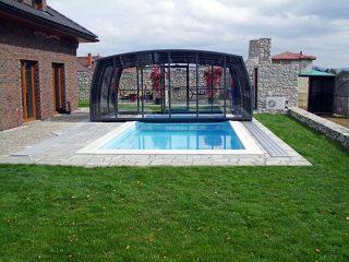Fully retracted swimming pool enclosure Omega