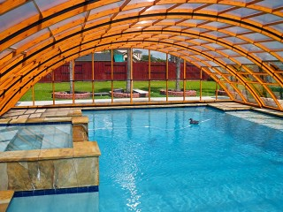 Inside view into pool enclosure Universe NEO with wood imitation finish