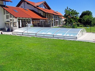Retractable swimming pool enclosure Imperia NEO light in white color