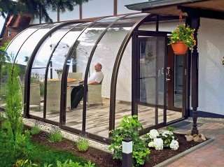 Satisfied customer enjoying new Patio Enclosure CORSO Entry