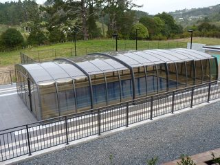 Swimming pool enclosure Omega with opening from the midle