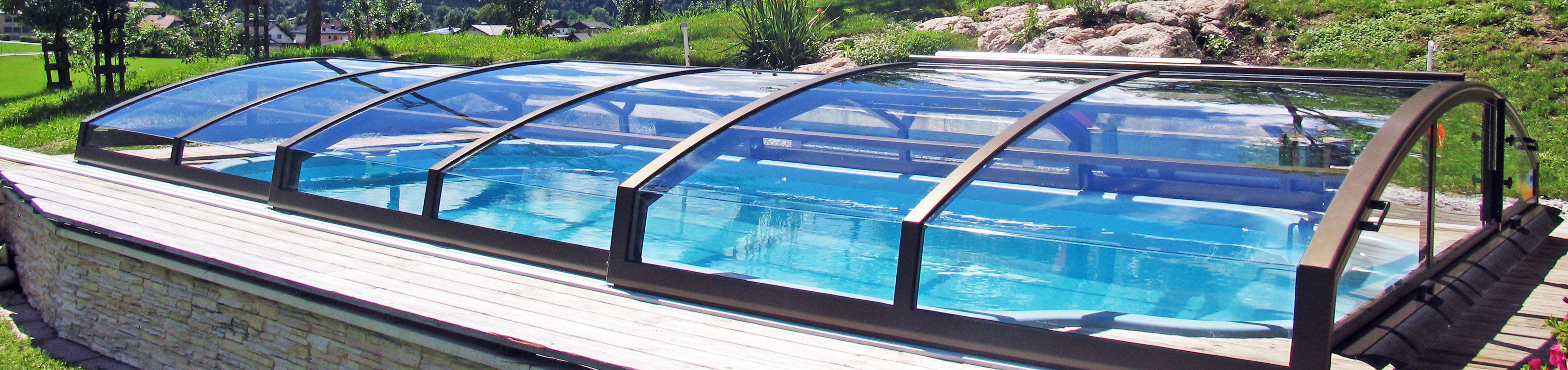 Closed retractable swimming pool enclosure imperia sunrooms Retractable swimming pool enclosures