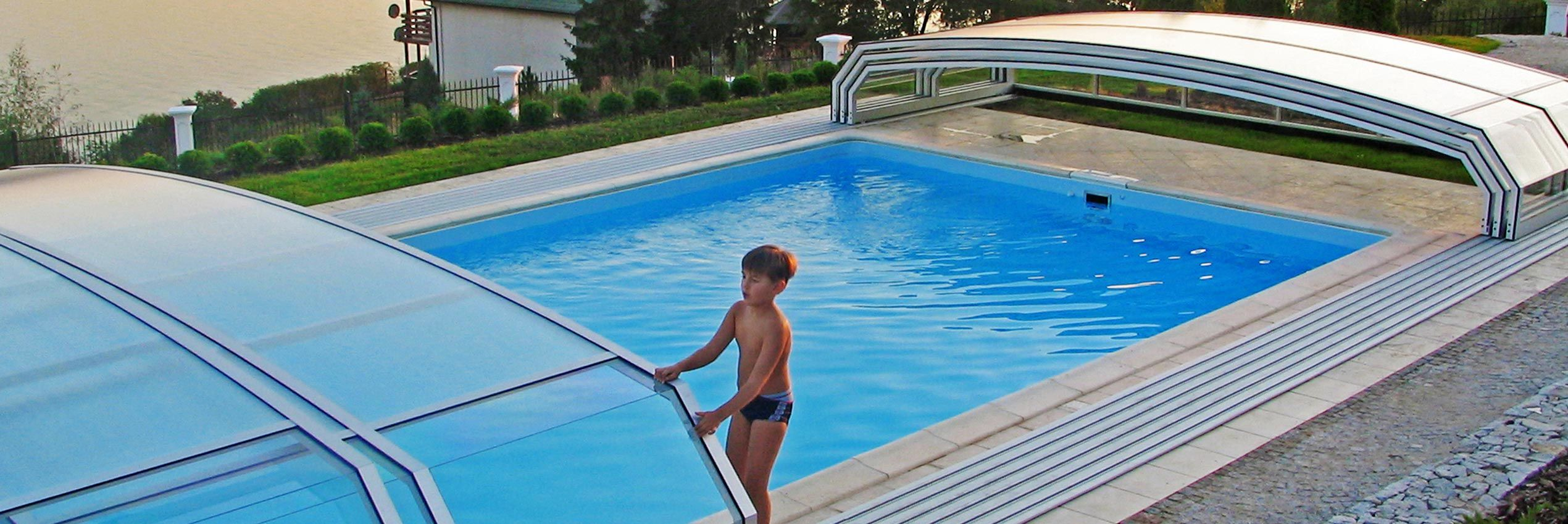 Retractable swimming pool enclosure oceanic low sunrooms Retractable swimming pool enclosures