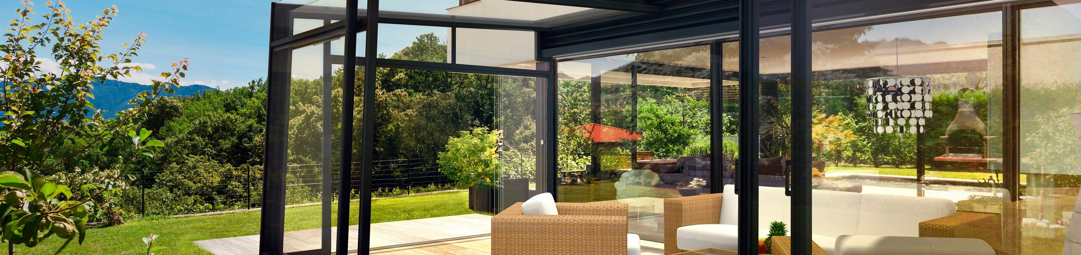 Opened retractable patio enclosure CORSO Ultima
