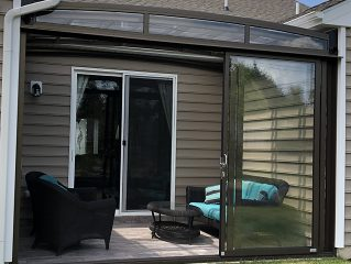 Comparison between conservatory and patio enclosure