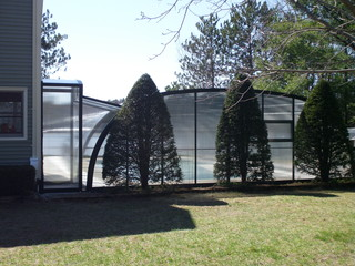 Atypical pool enclosure with corridor attached to house wall