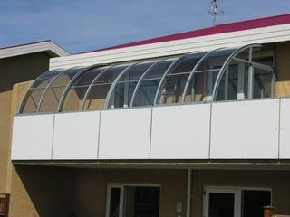 Clear and elegant patio enclosure CORSO Entry - a better patio cover