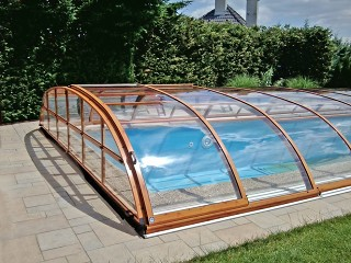 Closer look on pool enclosure Elegant NEO with wood imitation