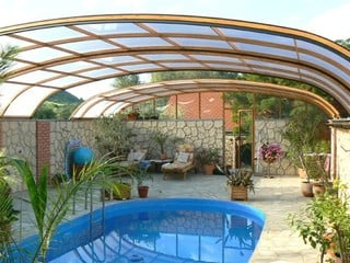 Apypical installation of pool enclosure Elegant on high wall