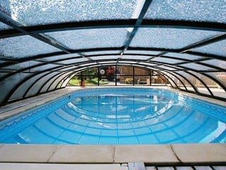 Elegant pool enclosure - low line pool cover - closed and ready to endure
