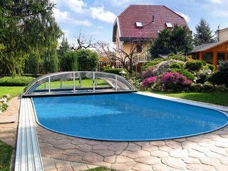 Elegant pool enclosure - low line pool cover - fully retracted