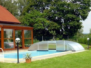 Elegant pool enclosure - low line pool cover - fully retracted with opened sliding door