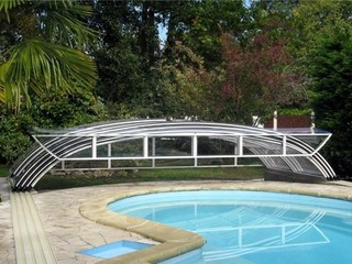 Elegant pool enclosure - low line pool cover - fully retracted  front face opened