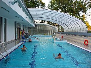 Retractable pool enclosure for public swimming pool