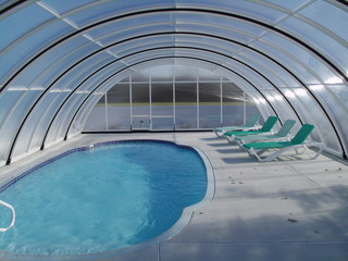 Enormous inside space of retractable pool enclosure Universe