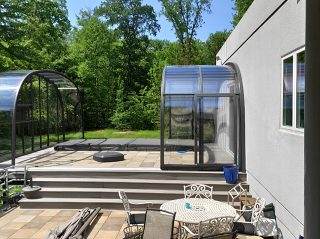 Fully opened pool enclosure Laguna with sealing profile on house wall