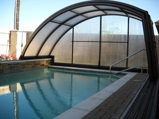 Fully opened pool enclosure Ravena on elevated wall