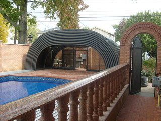 Fully opened retractable pool cover Laguna