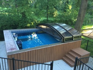 Fully retracted pool enclosure Imperia in backyard