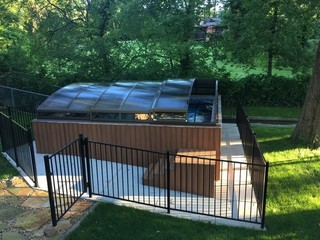 Imperia pool enclosure nicely complements your garden