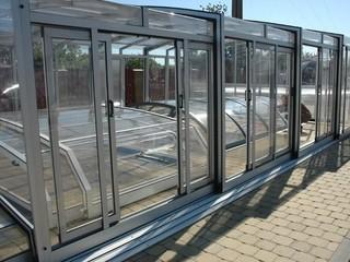 Inner doors for pool enclosures
