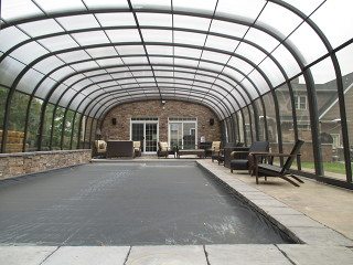 Inside look to swimming pool enclosure Laguna with dark polycarbonate filling