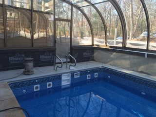 Inside of pool enclosure Style - built on a higher level wall
