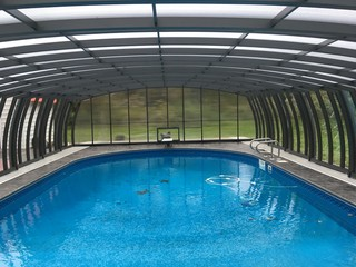 Inside space of pool enclosure Omega