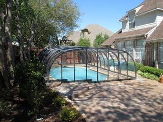 Laguna pool enclosure creates Carribean like paradise in your backyard