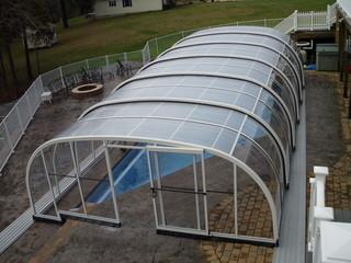 Laguna - pool enclosure looks great in every backyard