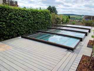 Low line swimming pool enclosure Terra on wooden deck
