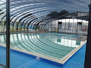massive swimming pool enclosure commercial application look from inside of enclosure - Inside Swimming Pool