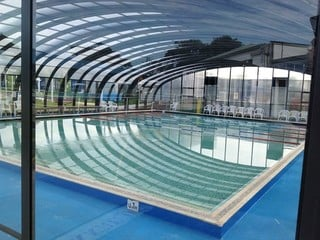 Massive swimming pool enclosure - commercial application - look from inside  of enclosure