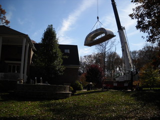 Moving the whole enclosure over house with crane