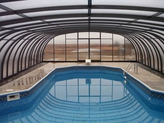 Newly installed pool enclosure Laguna from Pool and Spa Enclosures LLC.