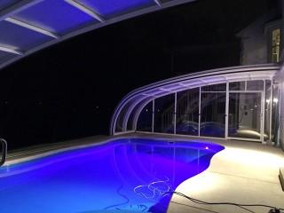 Night look on stylish enlightened pool enclosure Style
