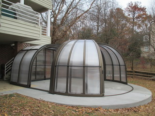 Opened pool enclosure Olympic on concrete deck